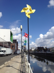 The canal near the Metro - pretty pinwheels on both sides broke up an otherwise dull cityscape